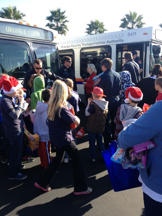 "<div class=""meta image-caption""><div class=""origin-logo origin-image ""><span></span></div><span class=""caption-text"">Generous donors share in the holiday spirit at the Stuff-A-Bus toy drive at the Honda Center in Anaheim on Friday, Dec. 21, 2012. (KABC Photo)</span></div>"