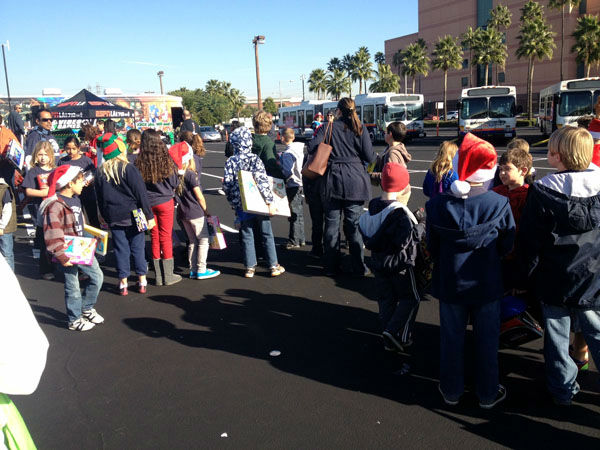 Generous donors share in the holiday spirit at the Stuff-A-Bus toy drive at the Honda Center in Anaheim on Friday, Dec. 21, 2012. <span class=meta>(KABC Photo)</span>