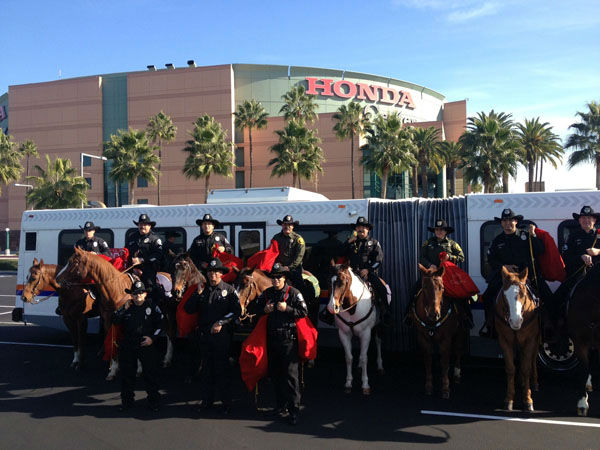 The Orange County Regional Mounted Unit visits the Stuff-A-Bus toy drive at the Honda Center in Anaheim on Friday, Dec. 21, 2012. <span class=meta>(KABC Photo)</span>