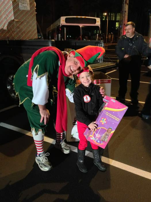 "<div class=""meta ""><span class=""caption-text "">Garth the Elf poses with a guest at the Stuff-A-Bus toy drive at the Honda Center in Anaheim on Friday, Dec. 21, 2012. (KABC Photo)</span></div>"
