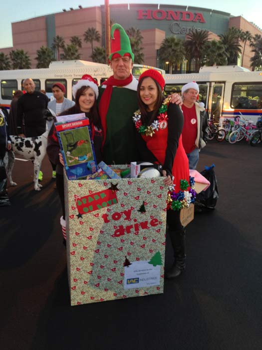 IAC Industries visits the Stuff-A-Bus toy drive at the Honda Center in Anaheim on Friday, Dec. 21, 2012. <span class=meta>(KABC Photo)</span>