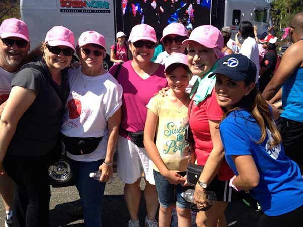 ABC7&#39;s Alysha Del Valle poses with participants at the Entertainment Industry Foundation Revlon Run&#47;Walk for Women in Exposition Park on Saturday, May 11, 2013. <span class=meta>(KABC Photo)</span>
