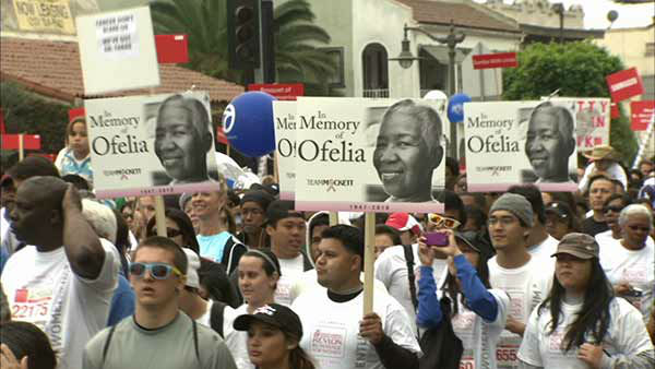 Participants hold up a sign reading, &#39;In Memory of Ofelia&#39; at the Entertainment Industry Foundation Revlon Run&#47;Walk for Women in Exposition Park on Saturday, May 11, 2013. <span class=meta>(KABC Photo)</span>