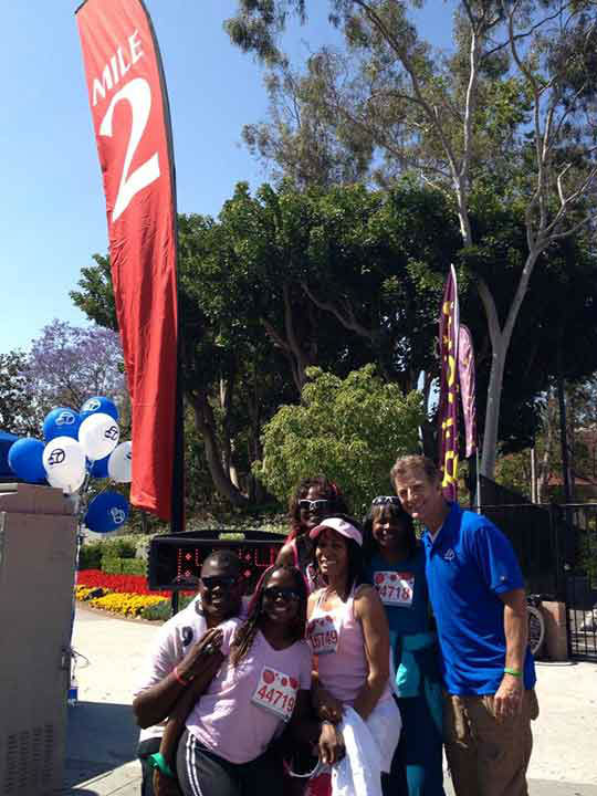 Eyewitness News anchor Phillip Palmer poses with participants at the Entertainment Industry Foundation Revlon Run&#47;Walk for Women in Exposition Park on Saturday, May 11, 2013. <span class=meta>(KABC Photo)</span>