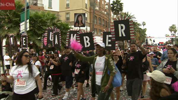 Participants hold up a sign at the Entertainment Industry Foundation Revlon Run&#47;Walk for Women in Exposition Park on Saturday, May 11, 2013. <span class=meta>(KABC Photo)</span>