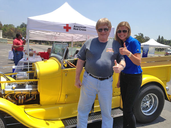 ABC7 Meteorologist Bri Winkler poses with a donor at a fundraising event at the Rose Bowl in Pasadena to help the victims of the Oklahoma tornado on Wednesday, May 22, 2013. <span class=meta>(KABC)</span>