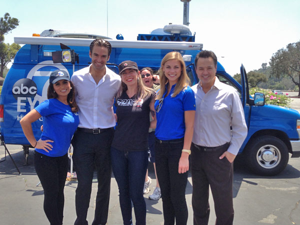 ABC7 Morning Traffic Reporter Alysha Del Valle, Reporter Elex Michaelson, Meteorologist Bri Winkler and Entertainment Guru George Pennacchio pose with an ABC7 viewer at a fundraising event at the Rose Bowl in Pasadena to help the victims of the Oklahoma tornado on Wednesday, May 22, 2013. <span class=meta>(KABC)</span>