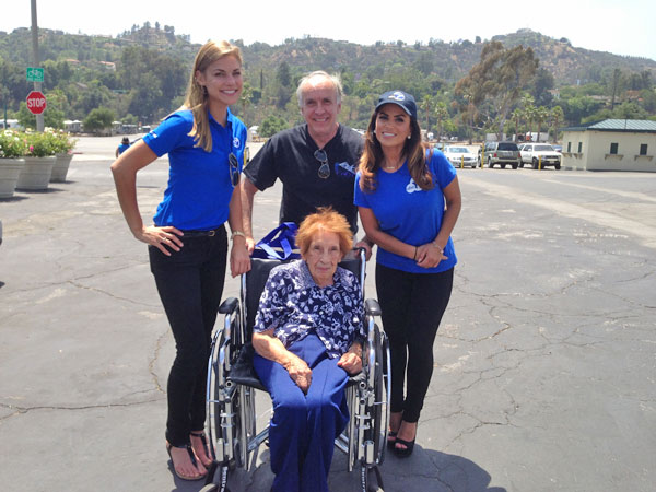 ABC7 Meteorologist Bri Winkler and Morning Traffic Reporter Alysha Del Valle pose with 97-year-old Juanita and another ABC7 viewer at a fundraising event at the Rose Bowl in Pasadena to help the victims of the Oklahoma tornado on Wednesday, May 22, 2013. <span class=meta>(KABC)</span>