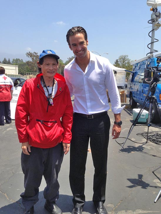 ABC7 Reporter Elex Michaelson poses with an ABC7 viewer at a fundraising event at the Rose Bowl in Pasadena to help the victims of the Oklahoma tornado on Wednesday, May 22, 2013. <span class=meta>(KABC)</span>