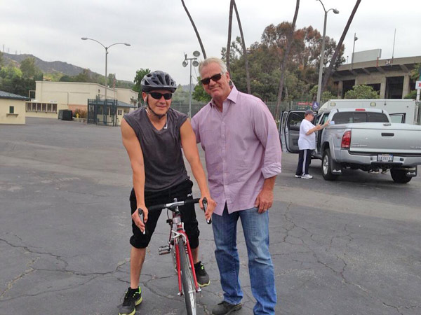 ABC7 Weathercaster Garth Kemp poses with a donor on his bike at a fundraising event at the Rose Bowl in Pasadena to help the victims of the Oklahoma tornado on Wednesday, May 22, 2013. <span class=meta>(KABC)</span>