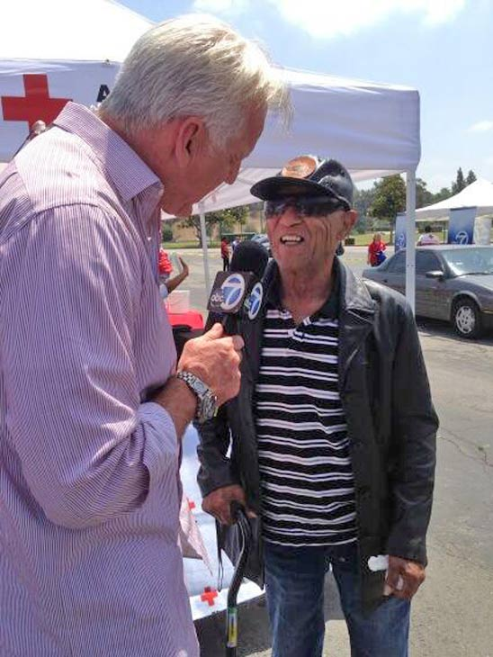 ABC7 Weathercaster Garth Kemp speaks with a donor at a fundraising event at the Rose Bowl in Pasadena to help the victims of the Oklahoma tornado on Wednesday, May 22, 2013. <span class=meta>(KABC)</span>