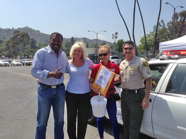 ABC7 Anchor Marc Brown poses with officials from the American Red Cross and the Los Angeles County Sheriff&#39;s Department Altadena Station at a fundraising event at the Rose Bowl in Pasadena to help the victims of the Oklahoma tornado on Wednesday, May 22, 2013. <span class=meta>(KABC)</span>