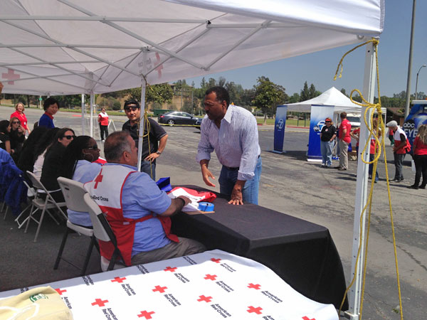 ABC7 Anchor Marc Brown talks with American Red Cross officials at a fundraising event at the Rose Bowl in Pasadena to help the victims of the Oklahoma tornado on Wednesday, May 22, 2013. <span class=meta>(KABC)</span>