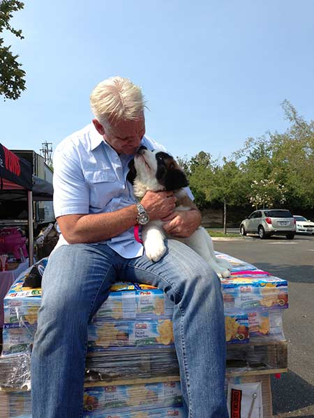 ABC7 Weathercaster Garth Kemp poses with Lulu the dog at the Feed SoCal event in Thousand Oaks on Friday, July 19, 2013. <span class=meta>(KABC Photo)</span>