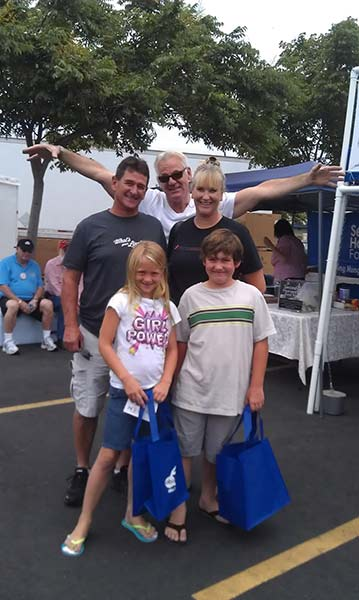 ABC7 Weathercaster Garth Kemp is seen with the Wilson family at the Feed SoCal event in Ontario on Friday, July 26, 2013. <span class=meta>(KABC Photo)</span>