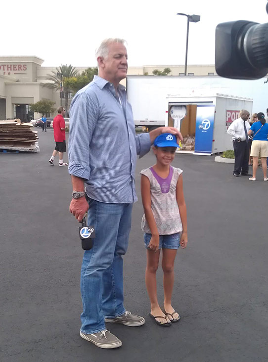 ABC7 Weathercaster Garth Kemp with Dalina, of Ontario, at the Feed SoCal event in Ontario on Friday, July 26, 2013. <span class=meta>(KABC Photo)</span>