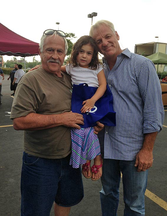 ABC7 Weathercaster Garth Kemp with 3-year-old Lexi of Hesperia at the Feed SoCal event in Ontario on Friday, July 26, 2013.
