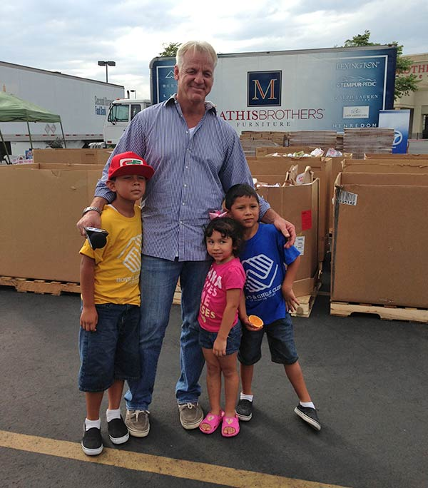 ABC7 Weathercaster Garth Kemp with Anthony, Abigail and Henry from Pomona at the Feed SoCal event in Ontario on Friday, July 26, 2013.