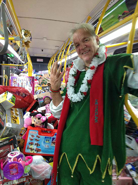 That&#39;s one smiling elf after our 4th bus of the day gets stuffed at Los Cerritos Center on Friday, Nov. 22, 2013. <span class=meta>(KABC Photo)</span>