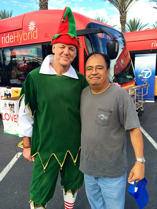 David Arcadio from Cerritos visits Garth the Elf at our first Stuff-A-Bus event of 2013 at Los Cerritos Center on Friday, Nov. 22, 2013. <span class=meta>(KABC Photo)</span>