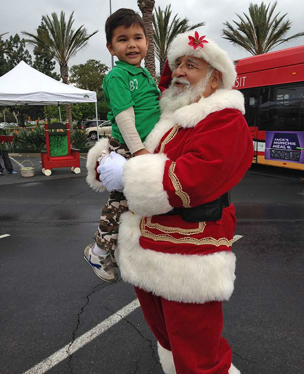 Four-year-old Diego from Lakewood visits Santa Claus at our first Stuff-A-Bus event of 2013 at Los Cerritos Center on Friday, Nov. 22, 2013. <span class=meta>(KABC Photo)</span>