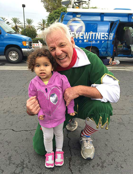 Two-year-old Farrah from Bellflower visits Garth the Elf at our first Stuff-A-Bus event of 2013 at Los Cerritos Center on Friday, Nov. 22, 2013. <span class=meta>(KABC Photo)</span>