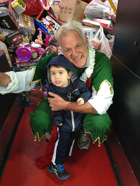 Two-year-old Jack from Lakewood visits Garth the Elf at our first Stuff-A-Bus event of 2013 at Los Cerritos Center on Friday, Nov. 22, 2013. <span class=meta>(KABC Photo)</span>