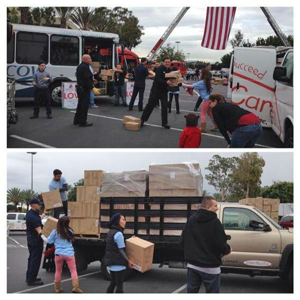 JAKKS Pacific donates boxes and boxes of toys and sports equipment for ABC7&#39;s Spark of Love Toy Drive at our first Stuff-A-Bus event of 2013 at Los Cerritos Center on Friday, Nov. 22, 2013. Thanks JAKKS! <span class=meta>(KABC Photo)</span>