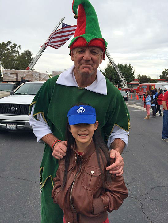 Ten-year-old Jenna Bartholomew from Cerritos visits Garth the Elf at our first Stuff-A-Bus event of 2013 at Los Cerritos Center on Friday, Nov. 22, 2013. <span class=meta>(KABC Photo)</span>