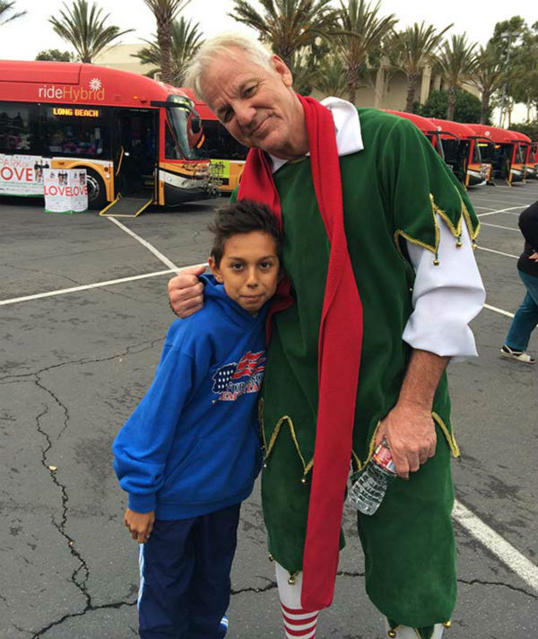 Eleven-year-old Joshua Olavarez from Hawaiian Gardens visits Garth the Elf at our first Stuff-A-Bus event of 2013 at Los Cerritos Center on Friday, Nov. 22, 2013. <span class=meta>(KABC Photo)</span>