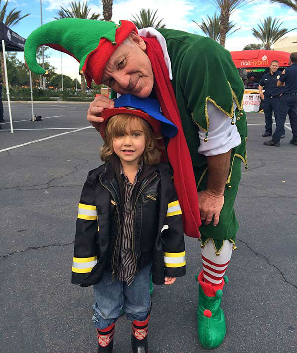 Three-year-old Kamauliola Nowaczyk from West Hills visits Garth the Elf at our first Stuff-A-Bus event of 2013 at Los Cerritos Center on Friday, Nov. 22, 2013. <span class=meta>(KABC Photo)</span>