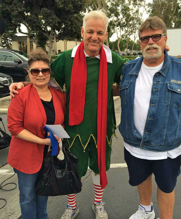 Mary and Leo Baca from Whittier visit Garth the Elf at our first Stuff-A-Bus event of 2013 at Los Cerritos Center on Friday, Nov. 22, 2013. <span class=meta>(KABC Photo)</span>