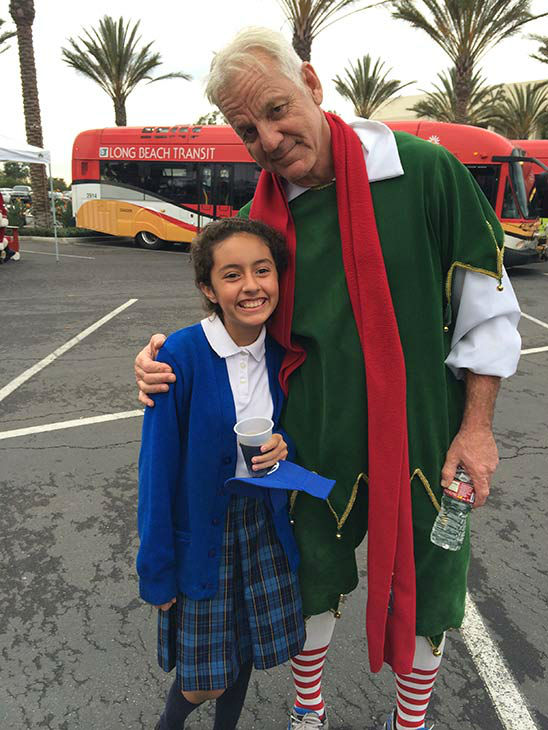 Ten-year-old Mia Jimenez from Norwalk visits Garth the Elf at our first Stuff-A-Bus event of 2013 at Los Cerritos Center on Friday, Nov. 22, 2013. <span class=meta>(KABC Photo)</span>