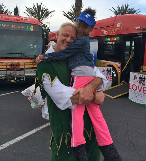 Seven-year-old Morgan Whittington from Lakewood visits Garth the Elf at our first Stuff-A-Bus event of 2013 at Los Cerritos Center on Friday, Nov. 22, 2013. <span class=meta>(KABC Photo)</span>