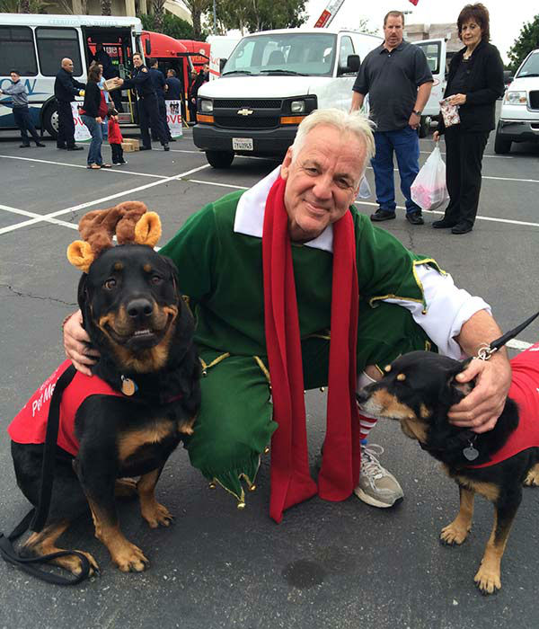 Garth the Elf hangs with his new buddies Maggie and Jasmine at our first Stuff-A-Bus event of 2013 at Los Cerritos Center on Friday, Nov. 22, 2013. <span class=meta>(KABC Photo)</span>