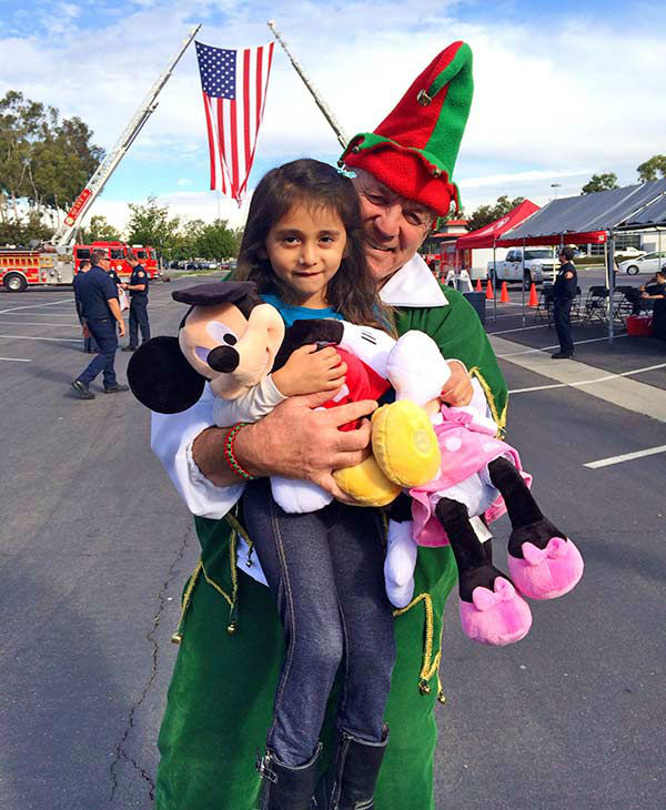 Four-year-old Reese from Bellflower visits Garth the Elf at our first Stuff-A-Bus event of 2013 at Los Cerritos Center on Friday, Nov. 22, 2013. <span class=meta>(KABC Photo)</span>