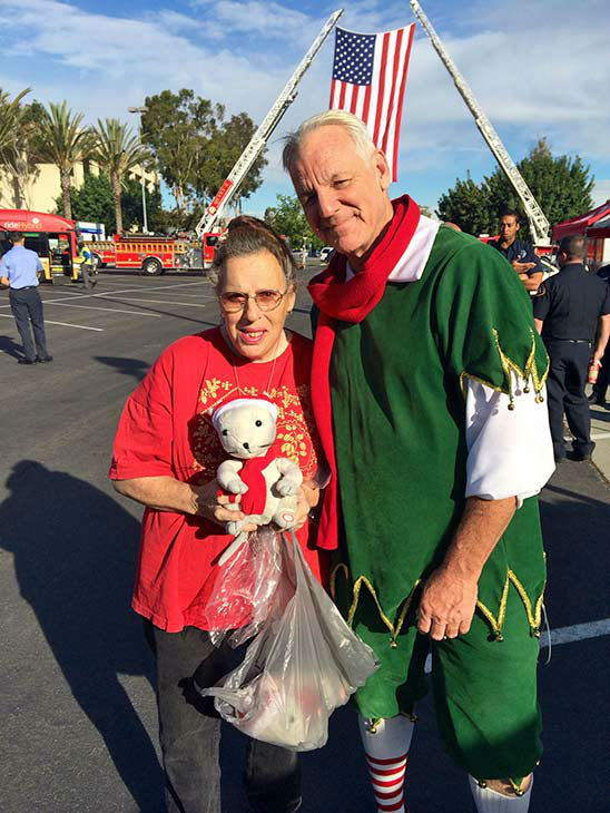 Sandra DeKay from Paramount visits Garth the Elf at our first Stuff-A-Bus event of 2013 at Los Cerritos Center on Friday, Nov. 22, 2013. <span class=meta>(KABC Photo)</span>