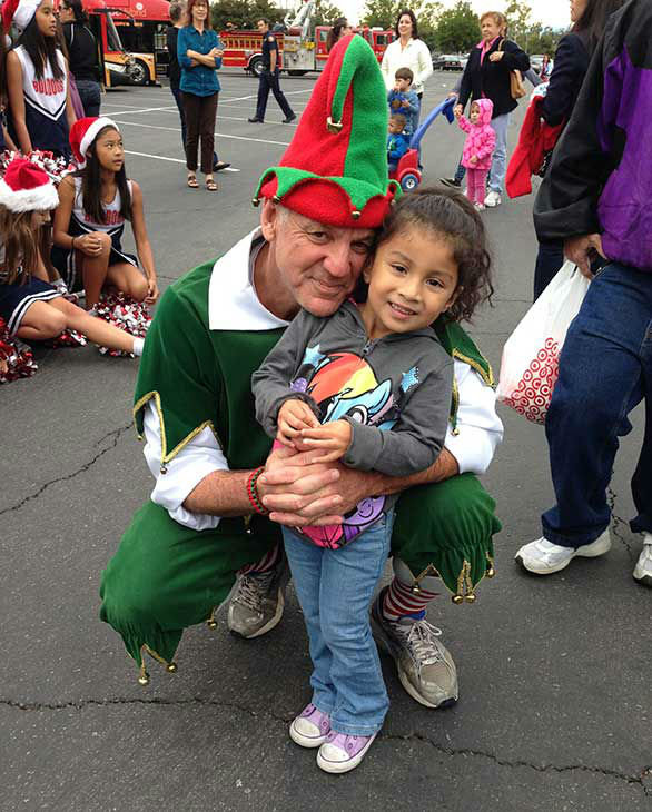 Four-year-old Sophia from Pico Rivera visits Garth the Elf at our first Stuff-A-Bus event of 2013 at Los Cerritos Center on Friday, Nov. 22, 2013. <span class=meta>(KABC Photo)</span>