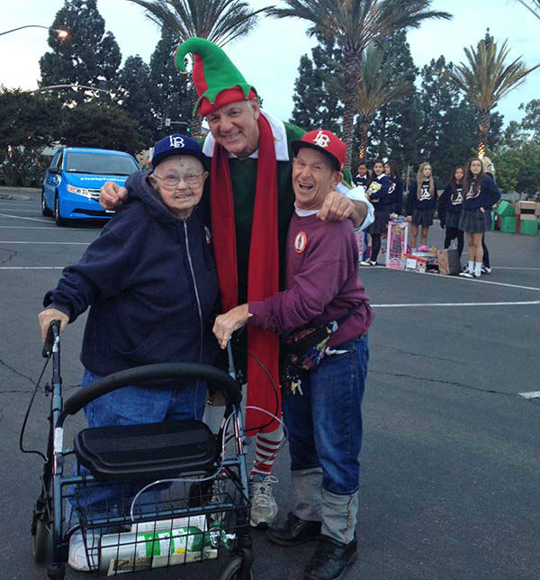 Garth the Elf poses with some generous ABC7 viewers at our first Stuff-A-Bus event of 2013 at Los Cerritos Center on Friday, Nov. 22, 2013. <span class=meta>(KABC Photo)</span>