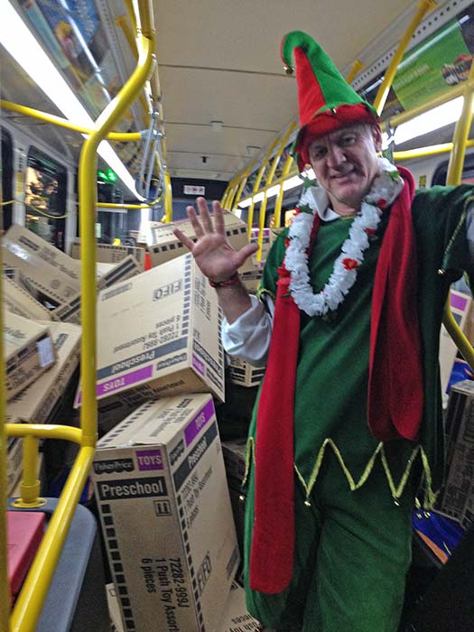 Garth the Elf poses for a photo after our 5th bus of the day gets stuffed at Los Cerritos Center on Friday, Nov. 22, 2013. <span class=meta>(KABC Photo)</span>