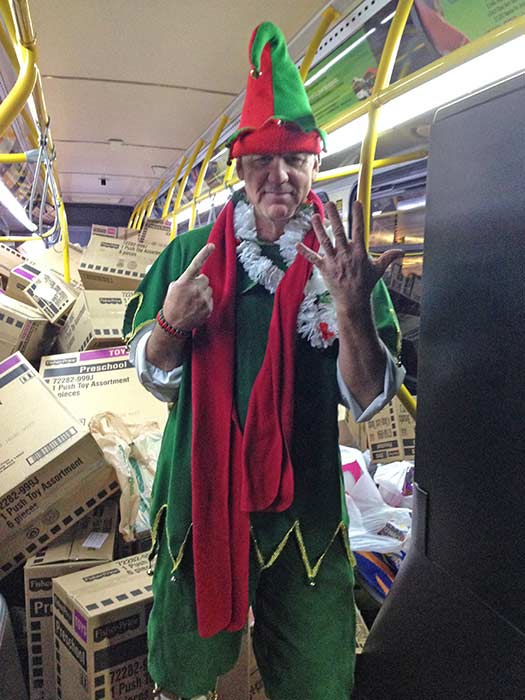 Garth the Elf poses for a photo after our 6th bus of the day gets stuffed at Los Cerritos Center on Friday, Nov. 22, 2013. <span class=meta>(KABC Photo)</span>