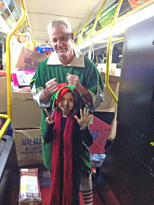 "<div class=""meta ""><span class=""caption-text "">Garth the Elf poses for a photo after our 7th bus of the day gets stuffed at Los Cerritos Center on Friday, Nov. 22, 2013. (KABC Photo)</span></div>"