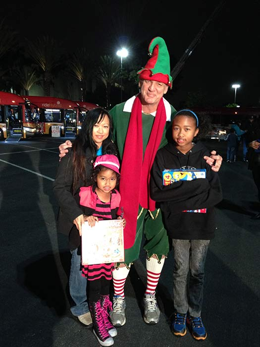 Garth the Elf poses with the Signo-Hawkins family from Cerritos at our first Stuff-A-Bus event of 2013 at Los Cerritos Center on Friday, Nov. 22, 2013. <span class=meta>(KABC Photo)</span>