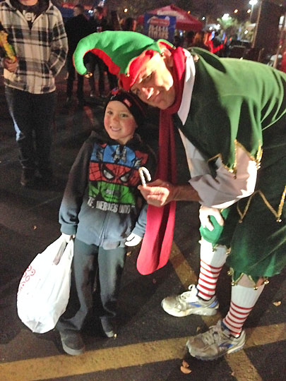 Hayden from Norco poses with ABC7&#39;s resident elf Garth Kemp at the Stuff-a-Bus event in Ontario Friday, Dec. 6, 2013. <span class=meta>(KABC Photo)</span>
