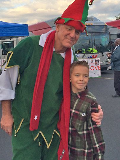 Justin, 10, of Corona, poses with ABC7&#39;s resident elf Garth Kemp at the Stuff-a-Bus event in Ontario Friday, Dec. 6, 2013. <span class=meta>(KABC Photo)</span>