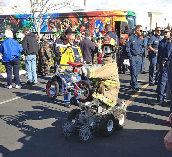 The Ontario Fire Department bomb squad robot hangs out at our Stuff-A-Bus event at Mathis Brothers in Ontario on Friday, Dec. 6, 2013. <span class=meta>(KABC Photo)</span>