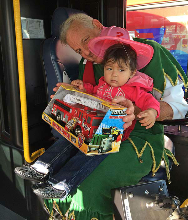 Garth the Elf poses with 1-year-old Briella from Redlands at our Stuff-A-Bus event at Mathis Brothers in Ontario on Friday, Dec. 6, 2013. <span class=meta>(KABC Photo)</span>
