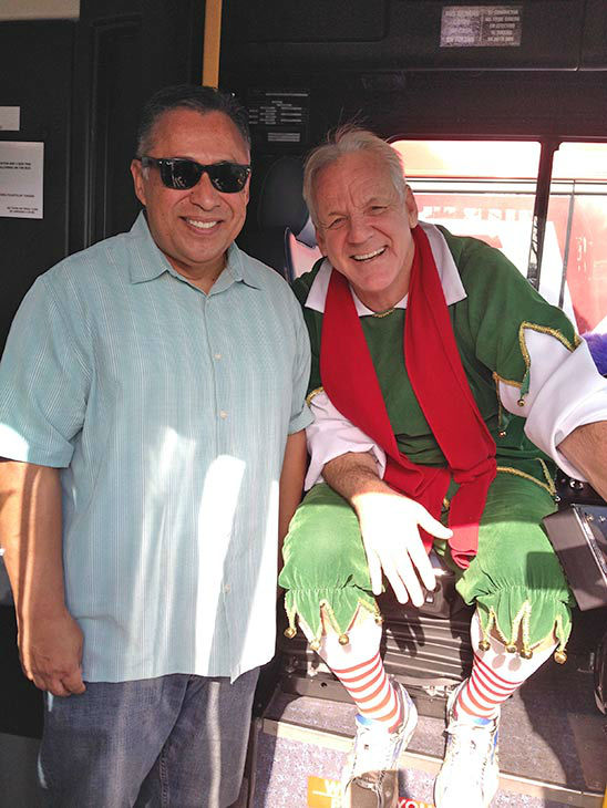 Garth the Elf poses with ABC7 viewer John at our Stuff-A-Bus event at Mathis Brothers in Ontario on Friday, Dec. 6, 2013. <span class=meta>(KABC Photo)</span>