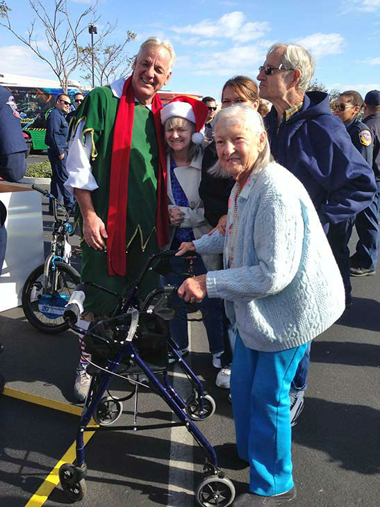 "<div class=""meta ""><span class=""caption-text "">Garth the Elf poses with some loyal ABC7 viewers at our Stuff-A-Bus event at Mathis Brothers in Ontario on Friday, Dec. 6, 2013. (KABC Photo)</span></div>"
