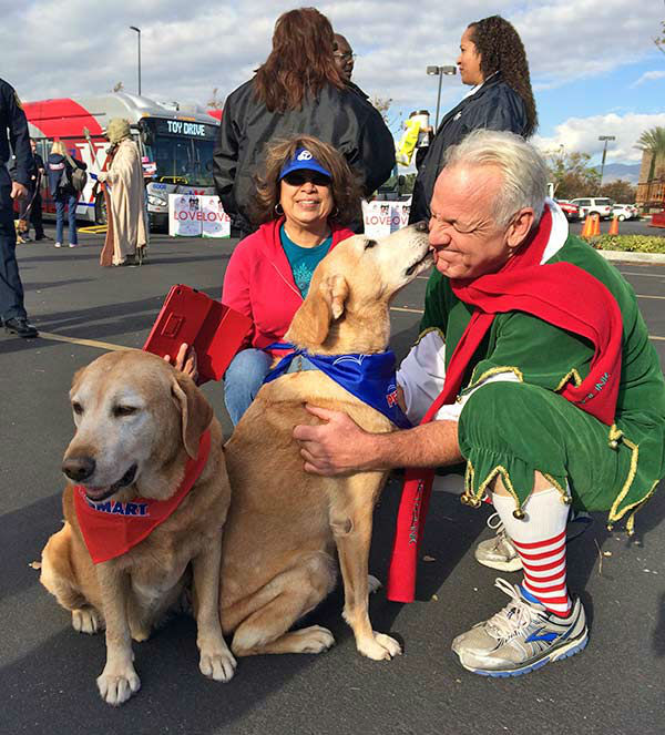 Garth the Elf gets some love from Jesse James and Doc Holiday at our Stuff-A-Bus event at Mathis Brothers in Ontario on Friday, Dec. 6, 2013. <span class=meta>(KABC Photo)</span>